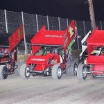 The stars of the ASCS Gulf South Region go three-wide during parade laps to salute the fans at Golden Triangle Raceway Park during the 2013 season. (RonSkinnerPhotos.com Photo)