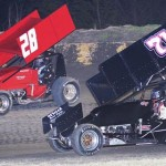 Tommy Bryant (28) and Channin Tankersley race for position during Friday's ASCS Gulf South Region event at Golden Triangle Raceway Park in Texas. (RonSkinnerPhotos.com Photo)