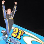 Ray Allen Kulhanek celebrates after winning the season opener for the ASCS Gulf South Region at Golden Triangle Raceway Park Friday. (RonSkinnerPhotos.com Photo)