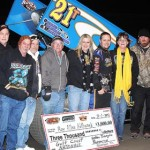 Ray Allen Kulhanek stands in victory lane with family and crew after winning at Golden Triangle Raceway Park Friday. (RonSkinnerPhotos.com Photo)