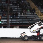 Aaron Reutzel crosses under the checkered flag to win Saturday's ASCS Gulf South Region feature at Battleground Spedway in Highlands, Texas. (RonSkinnerPhotos.com Photo)