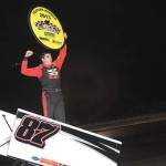 Aaron Reutzel celebrates his victory at Battleground Speedway in Highlands, Texas. (RonSkinnerPhotos.com Photo)