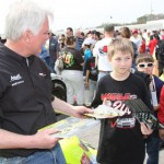 Frank Kimmel signs autographs for young fans prior to the start of Saturday's ARCA event at Mobile Int'l Speedway. (ARCA Racing Series Photo)