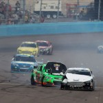 The damaged cars of Danica Patrick (10) and David Ragan (34) roll away from the scene of an accident during Sunday's Subway Fresh Fit 500 at Phoenix Int'l Raceway. (NASCAR Photo)