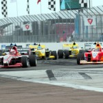 Shelby Blackstock (28) leads the Pro Mazda Championship field into the first turn at the start of Sunday's race in St. Petersburg, Fla. (Pro Mazda Photo)