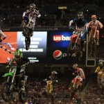 Riders including Ryan Villopoto (1), Chad Reed (22), Ryan Dungey (5), Davi Millsaps (18) and Trey Canard (41) glide through the air Saturday night in St. Louis. (Pete Richards photo)