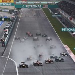 The Formula One field flows down the front stretch at the start of Sunday's Malaysian Grand Prix. (Steve Etherington Photo)
