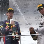 Sebastian Vettel (left) and Lewis Hamilton celebrate on the podium Sunday after the Malaysian Grand Prix. (Steve Etherington Photo)