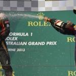 Sebastian Vettel (right) sprays Australian Grand Prix winner Kimi Raikkonen with a little champagne during the podium ceremony at Albert Park Sunday. (Steve Etherington Photo)