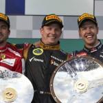 Kimi Raikkonen (center) celebrates on the Australian Grand Prix podium with second-place finisher Fernando Alonso (left) and third-place finisher Sebastian Vettel (right). (Steve Etherington Photo)