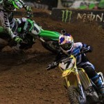 James Stewart (7) and Ryan Villopoto fight for the lead inside the Edward Jones Dome in St. Louis. (Pete Richards photo)