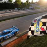 The No. 01 Chip Ganassi Racing BMW Riley crosses the finish line to win Saturday's Grand-Am Rolex Sports Car Series race at Road Atlanta. (Grand-Am Photo)