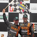 Max Angelelli (left) and Jordan Taylor celebrate after winning Saturday at Barber Motorsports Park. (Grand-Am Photo)
