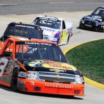 Ty Dillon leads a pack of trucks through turns three and four during Saturday's NASCAR Camping World Truck Series Kroger 250 at Martinsville (Va.) Speedway. (HHP/Christa L. Thomas Photo)