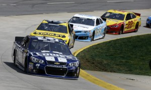 Jimmie Johnson leads the NASCAR Sprint Cup Series field through a corner at Martinsville (Va.) Speedway in the spring. (HHP/Harold Hinson Photo)