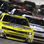 Brian Scott (2) leads Nelson Piquet Jr. (30) and others into a corner Friday during NASCAR Nationwide Series competition at Texas Motor Speedway. (HHP/Brian Lawdermilk Photo)