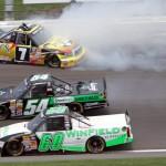 John Wes Townley (7) crashes as Dakoda Armstrong (60) and Darrell Wallace Jr. drive below him Saturday at Kansas Speedway during the NASCAR Camping World Truck Series SFP 250. (HHP/Alan Marler Photo)