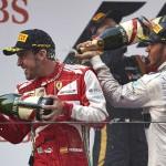 Fernando Alonso (left) celebrates after winning the Chinese Grand Prix alongside third-place finisher Lewis Hamilton (right). (Steve Etherington Photo)