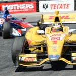 Ryan Hunter-Reay (1) leads eventual race winner Takuma Sato through a turn during Sunday's IZOD IndyCar Series Toyota Grand Prix of Long Beach. (Al Steinberg Photo)