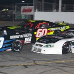 Austin Theriault (29), D.J. Shaw (60) and Johanna Long battle for position during Saturday's PASS South Easter Bunny 150 at Hickory (N.C.) Motor Speedway. (Chris Owens Photo)