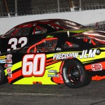 D.J. Shaw (60) works his way under Roger Lee Newton Saturday night at Hickory (N.C.) Motor Speedway. (Chris Owens Photo)