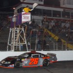Preston Peltier crosses under the checkered flag to win Saturday's Easter Bunny 150 at Hickory (N.C.) Motor Speedway. (Chris Owens Photo)