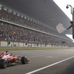 Fernando Alonso takes the checkered flag to win Sunday's Chinese Grand Prix. (Steve Etherington Photo)