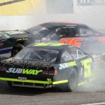 Bobby Therrien goes around as other competitors try to get by during Sunday's American-Canadian Tour event at Lee (N.H.) USA Speedway. (Leif Tillotson Photo)