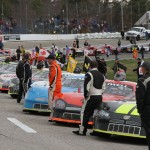 Drivers stand beside their cars prior to the start of the American-Canadian Tour feature Sunday at Lee (N.H.) USA Speedway. (Leif Tillotson Photo)