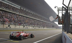 Fernando Alonso takes the checkered flag to win last year's Chinese Grand Prix. (Steve Etherington photo)