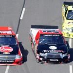 James Buescher (31), Darrell Wallace Jr. (54) and Matt Crafton battle for position Saturday at Martinsville (Va.) Speedway. (NASCAR Photo)