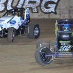 Chase Stockon (32) battles Hunter Schuerenberg Saturday night during AMSOIL USAC National Sprint Car Series action at Lawrenceburg (Ind.) Speedway. (Ginny Heithaus Photo)