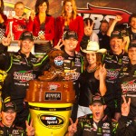 Kyle Busch and his crew celebrate in victory lane at Texas Motor Speedway on Saturday. (Owen Richards Photo)