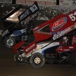 Paul McMahan (51) and Tim Kaeding race side-by-side at Tri-State Speedway in Haubstadt, Ind., on Saturday. (Mark Funderburk Photo)
