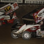 Steve Kinser (11) battles Chad Kemenah during Saturday's World of Outlaws STP Sprint Car Series event at Tri-State Speedway in Haubstadt, Ind. (Mark Funderburk Photo)