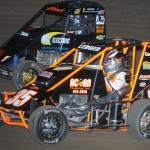 Cody Ledger (35) passes J.D. Black to win the companion midget feature at Valley Speedway in Grain Valley, Mo., on Friday. (Ken Simon Photo)