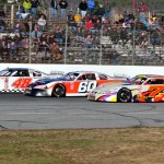 Bobby Timmons (48), Tim Brackett (60) and Glen Luce mix it up early on at Oxford Plains Speedway in Maine during Sunday's PASS North opener. (Ken MacIsaac Photo)