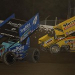 Cody Darrah (4) battles Joey Saldana for the lead during Saturday's World of Outlaws STP Sprint Car Series race at Tri-State Speedway. (Mark Funderburk Photo)