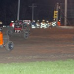 Robert Ballou (17rw), Kevin Thomas Jr. (17t) and Thomas Meseraull battle during Friday's AMSOIL USAC National Sprint Car Series race at Gas City (Ind.) I-69 Speedway. (Gordon Gill Photo)