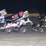 Lucas Oil American Sprint Car Series drivers battle for position Friday at Golden Triangle Raceway Park. (RonSkinnerPhotos.com Photo)