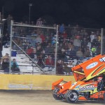 Brad Loyet flashes under the checkered flag to win Friday's Lucas Oil American Sprint Car Series race at Golden Triangle Raceway Park. (RonSkinnerPhotos.com Photo)