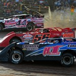 Dave Hess Jr. (44H) races three- wide with Russ King (56) and Jared Miley during the late-model portion of the Steel City Stampede at Lernerville Speedway. (Joe Secka/JMS Pro Photo)