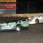 Jimmy Owens (20), pictured racing under Jimmy Mars for the lead en route to winning Saturday's NDRL late model race at Federated Auto Parts Raceway at I-55 in Pevely, Mo. in 2013, won at LaSalle Speedway on Saturday. (Don Figler photo)
