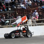 Todd Bertrand crosses the finish line to win Sunday's Northeastern Midget Ass'n event at Waterford (Conn.) Speedbowl. (Dick Ayers Photo)