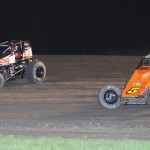 Kevin Thomas Jr (17t) passes Robert Ballou during Friday's AMSOIL USAC National Sprint Car Series event at Gas City (Ind.) I-69 Speedway. (Gene Crucean Photo)