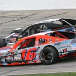 Ryan Preece (16) and Todd Szegedy battle for position during Sunday's NASCAR Whelen Modified Tour Icebreaker at Thompson (Conn.) Int'l Speedway. (Dick Ayers Photo)