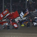Tim Shaffer (83), Caleb Helms (40), Cap Henry (54) and Dale Blaney (2) lead a four-wide salute to the fans prior to Saturday's UNOH All Star Circuit of Champions sprint-car race at Attica (Ohio) Raceway Park. (Action Photo)