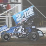 Dale Blaney crosses under the checkered flag to win Saturday's UNOH All Star Circuit of Champions event at Attica (Ohio) Raceway Park. (Action Photo)
