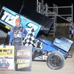 Dale Blaney stands in victory lane after winning Saturday night at Attica (Ohio) Raceway Park. (Action Photo)