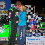 Shane Clanton gets a celebratory kiss in victory lane after winning Friday's World of Outlaws Late Model Series feature at Smoky Mountain Speedway in Maryville, Tenn. (Michael Moats Photo)